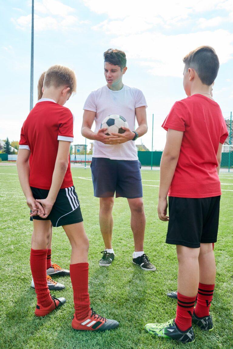 Coach Talking to Junior Football Team