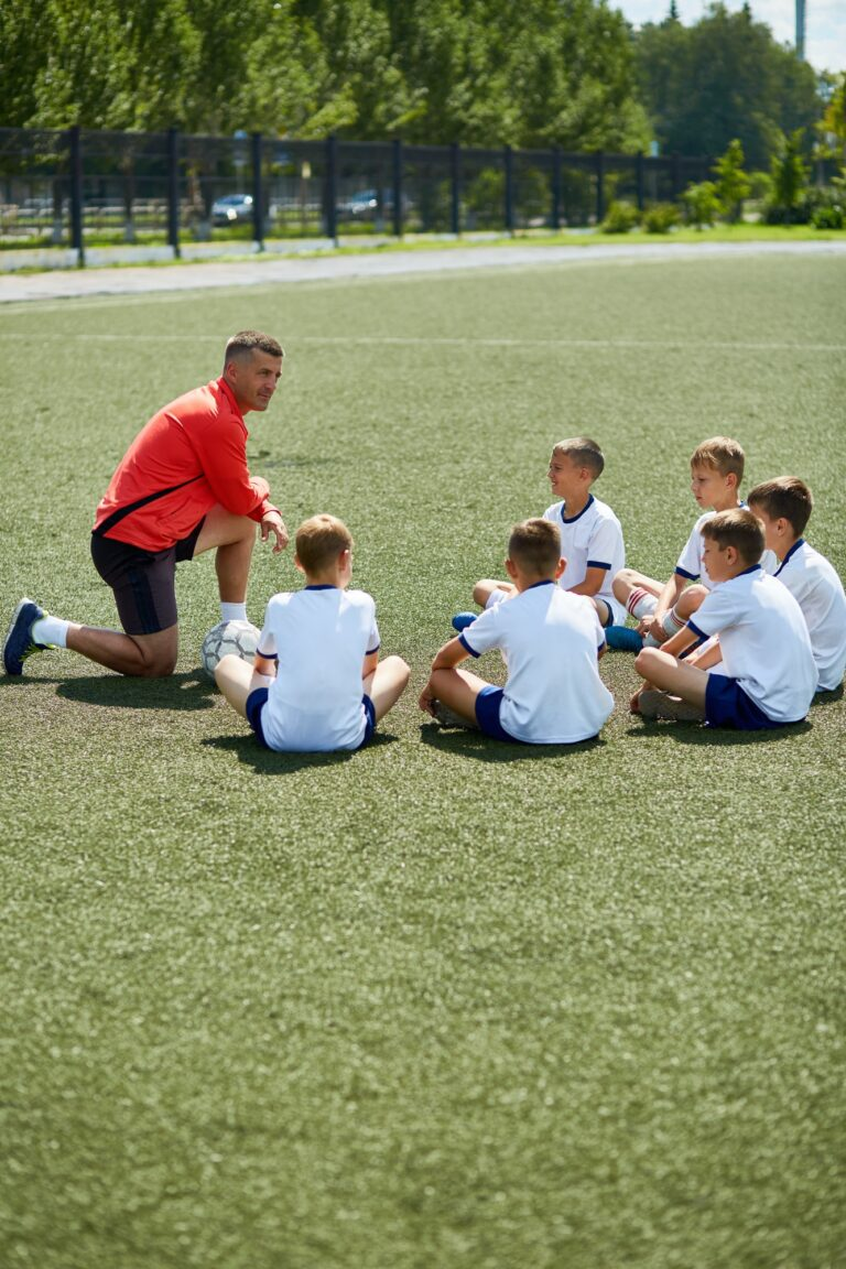 Coach Talking to Junior Football Team